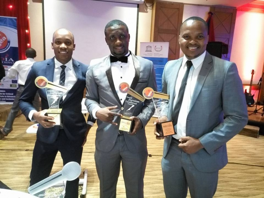 Francis Ontomwa (left) and Francis Mtalaki (right) together with their former colleague Eddy Job who is currently attached to the Deputy President William Ruto's press unit pose for a photo after being awarded at the Annual Journalism Excellence Awards 2017-Press Freedom Television category